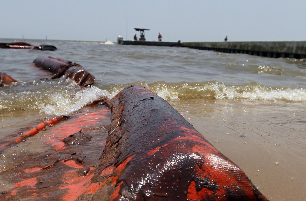 An oil coated containment boom is seen on the beach after it was moved out of place by high winds and waves in the past days which brought oil ashore from the Deepwater Horizon oil spill in the Gulf of Mexico on July 9, 2010 in Waveland, Mississippi.