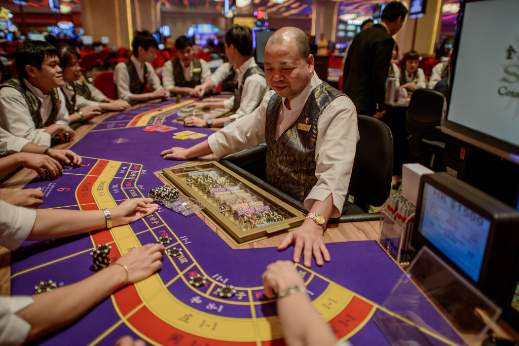 This picture taken on September 19, 2012 shows a Sands casino employees during training in Macau. Las Vegas casino boss Sheldon Adelson unveiled plans September 20, 2012 to build a scaled down replica of the Eiffel Tower as part of a new 3 billion USD gambling resort in Macau.