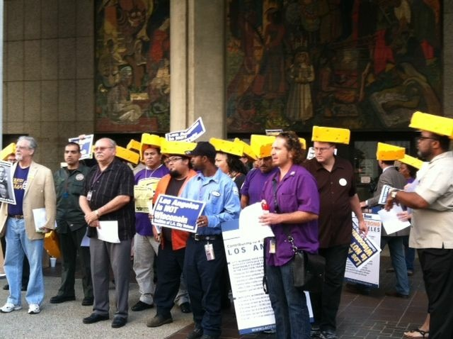 Workers with SEIU Local 721 rally against the city's proposed pension plan. Sept. 25, 2012.