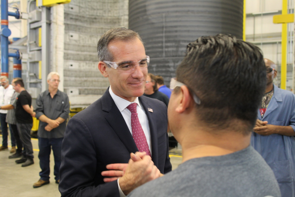 Mayor Eric Garcetti meets with a worker at Aerojet Rocketdyne's 100,000 square foot manufacturing facility in Canoga Park, Oct. 1, 2018.