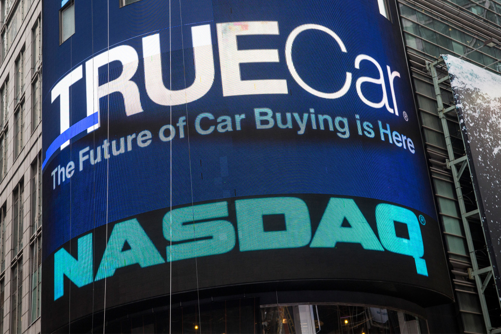 TrueCar's logo is displayed on the Nasdaq billboard in Times Square on May 16, 2014 in New York City.