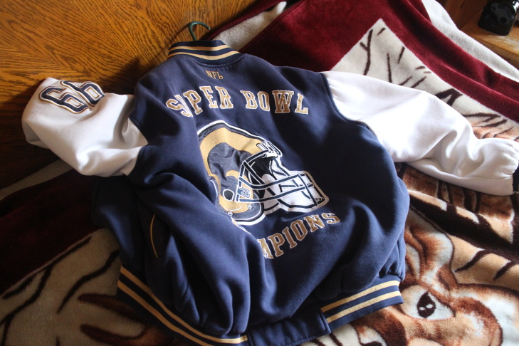 Ernie Garcia showing off one of his prized possessions, his authentic Rams letterman's jacket