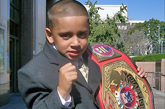 Mighty Mo puts up his dukes with his championship belt.