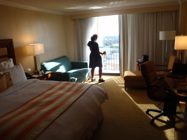 A housekeeper cleaning a hotel room. Would a panic button be a solution to battle instances of sexual harassment?