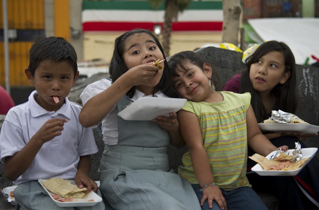 Children eat portions of a 50-metre-long