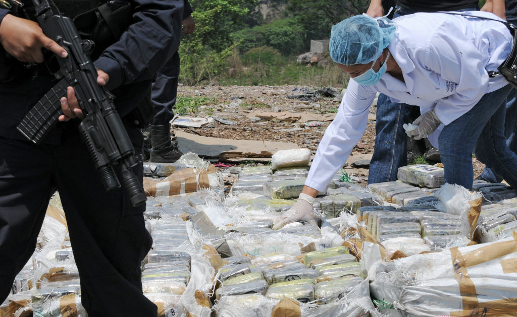 Forensic personnel prepare about 400kg of cocaine to be burnt in Tegucigalpa on May 11, 2012. The drug was seized this week in a joint operation, between the Police and the Army in La Mosquita, on the border with Nicaragua.