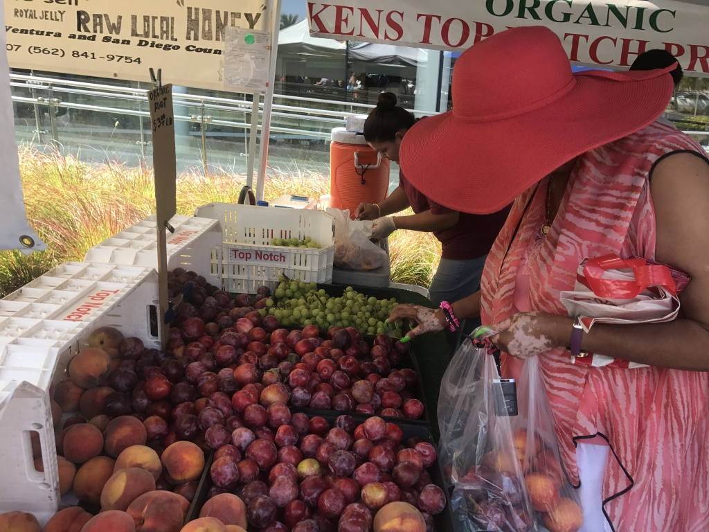 A shopper browses fruit from Ken's Produce based in Reedley, CA.