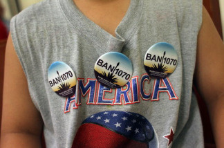 A boy wears buttons opposing Arizona's new immigration enforcement law SB 1070