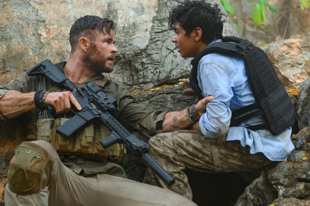 Chris Hemsworth and Rudhraksh Jaiswal in Extraction.