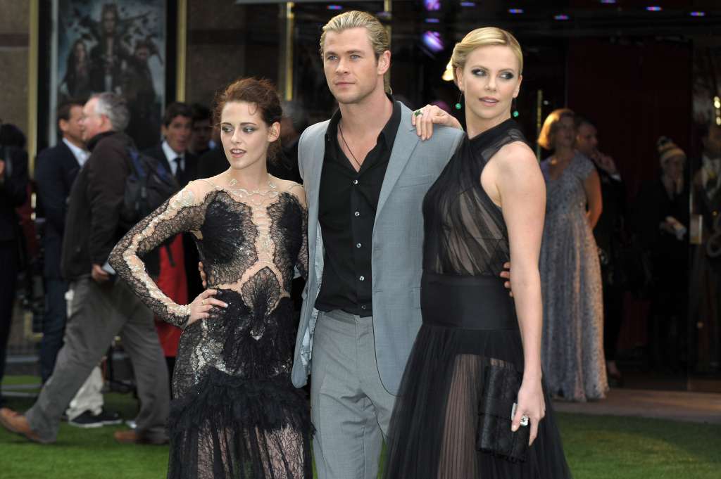 (L-R) Actors Kristen Stewart, Chris Hemsworth and Charlize Theron play Snow White, the Huntsman and Ravenna (the wicked queen) in