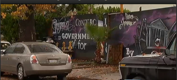 Occupy LA protesters put up a makeshift wall at a Los Angeles home under foreclosure proceedings.