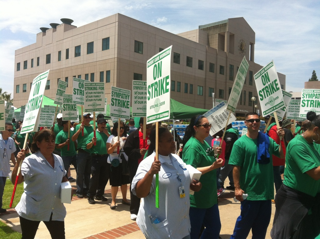 Health workers represented by The American Federation of State, County and Municipal Employees (AFSCME) union protest outside of UCLA on May 21, 2013.