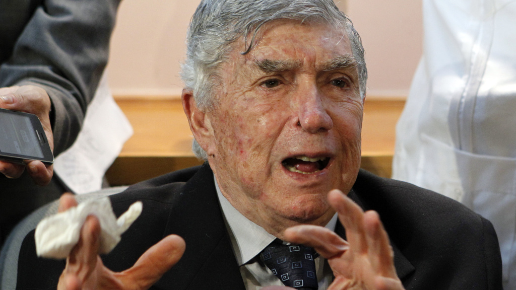 Anti-Castro activist Luis Posada Carriles gestures as he responds to a reporter during a news conference in Miami on April 13, 2011.