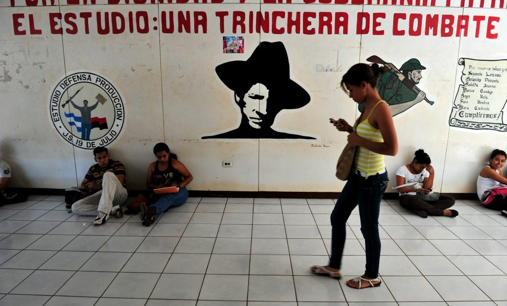Students read their books at the National Autonomous University of Nicaragua (UNAN) in Managua on November 14, 2012.