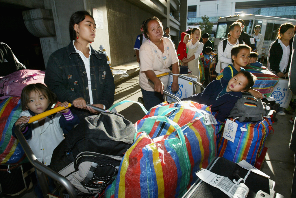 File photo: Hmong refugees get ready to board a bus for Fresno after arriving on the first chartered aircraft carrying 289 Hmong passengers to the Los Angeles airport on August 23, 2004 in Los Angeles, California.
