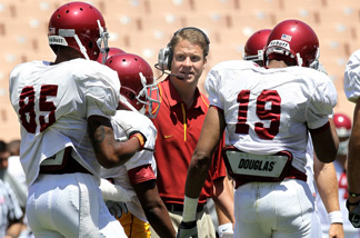 Head coach Lane Kiffin gives instructions in the offensive huddle during the USC Trojans spring game on May 1, 2010 at the Los Angeles Memorial Coliseum in Los Angeles, California. The Trojans play the University of Hawaii in Honolulu to open the 2010 college football season. Kickoff is 8 p.m.