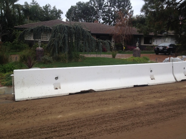 Glendora homeowner Trish Emery said she's thinking of ways to make the semi-permanent K-rail concrete barriers in front of her house look better since they'll remain in place for at least the next three years.