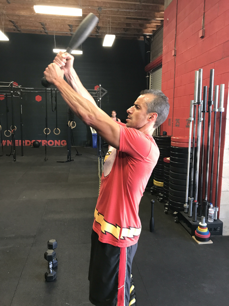 """Take Two's A Martinez tests one of the """"swords"""" at Nerdstrong as part of his """"Sinister 7"""" workout."""