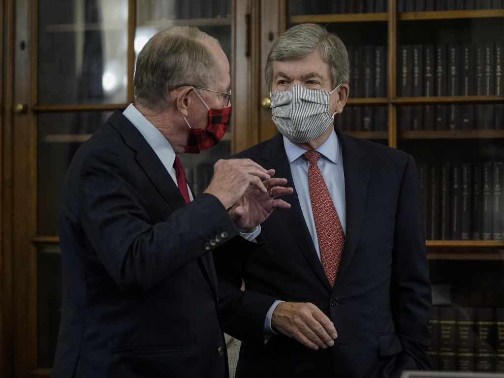Sen. Lamar Alexander, left, speaks with Sen. Roy Blunt  before the start of a Senate Rules Committee hearing Wednesday.
