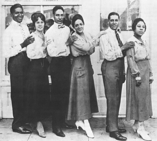 Jelly Roll Morton (third from left) and bandmates outside the Cadillac Cafe in 1918.