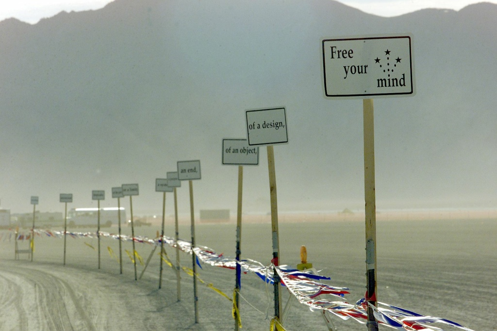 Signs are posted at the entrance of Black Rock City during the Burning Man Festival in Nevada Sept. 1, 2000.