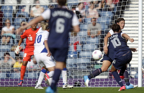 Carli Lloyd scores the U.S. team's winning goal, in a comeback win over France. The Americans are bidding for their third straight Olympic gold medal.