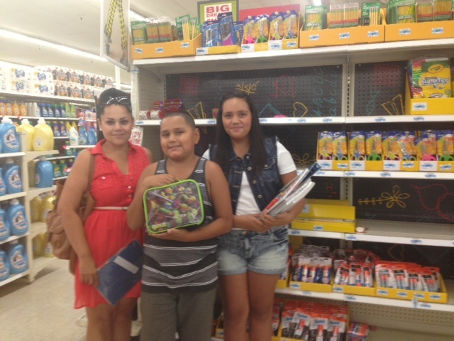 Renee Martinez and her two kids, Domanick and Alyssa, shop for school supplies at Kmart in Temple City. Martinez, who is unemployed, said she is cutting back on the amount of money spent on school supplies this year.