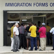 A line forms near the entrance of the Immigration and Naturalization Service office in Miami, 30 April 2001, as the midnight deadline approaches for illegal immigrants to apply for visas.