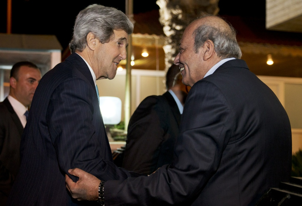 US Secretary of State John Kerry (L) is greeted by Palestinian Ambassador to Jordan Attallah Khairy, outside the Palestinian Ambassadors Residence in Amman where he will meet with Palestinian president Mahmud Abbas for talks on the Middle East peace process, as crunch decisions loom in the coming days on March 26, 2014.
