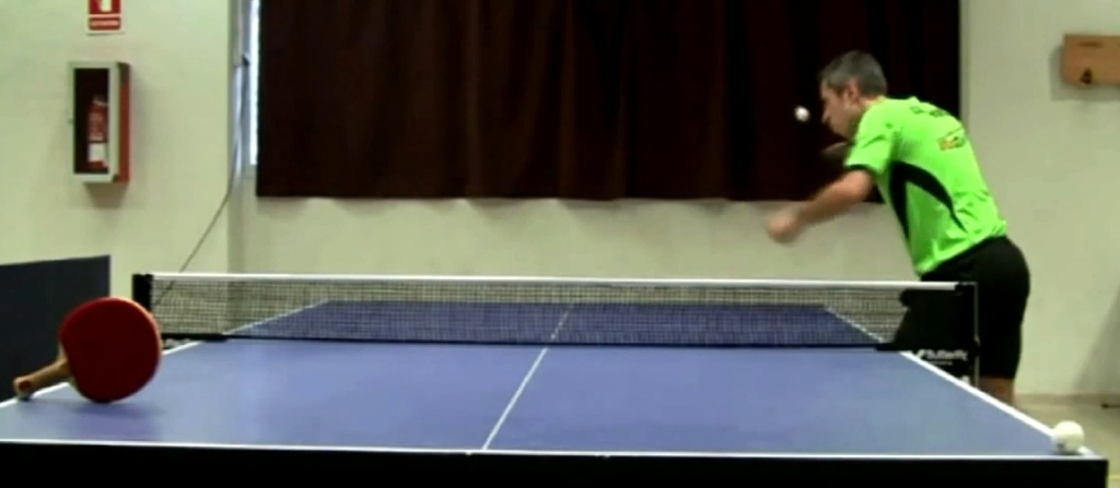 Screen shot from Josep Antón Velázquez's winning video in the STIGA 2013 ITTF Trick Shot Showdown.
