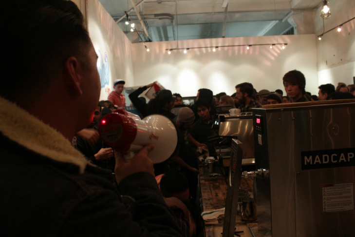 Competitors pour steamed milk into espresso to make latte art.