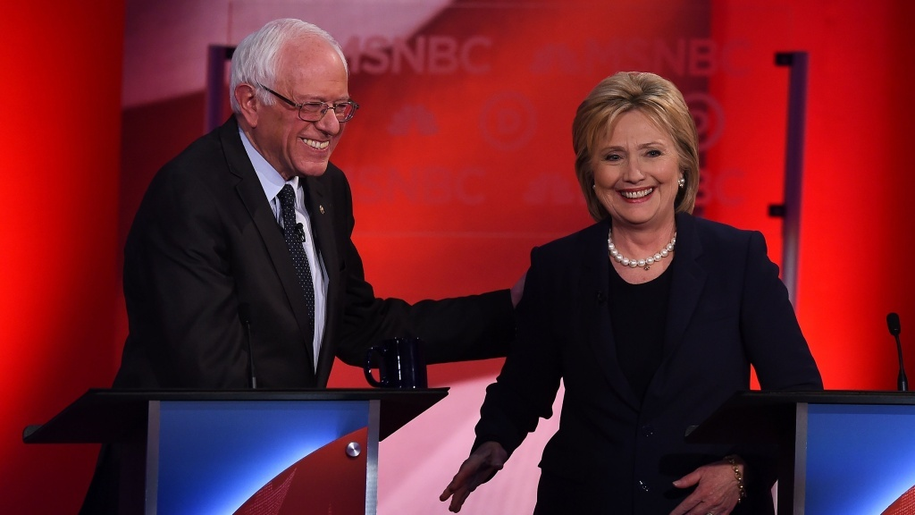 FILE: U.S. Democratic presidential candidates Hillary Clinton and Bernie Sanders participate in the MSNBC Democratic Candidates Debate at the University of New Hampshire in Durham on Feb. 4, 2016.