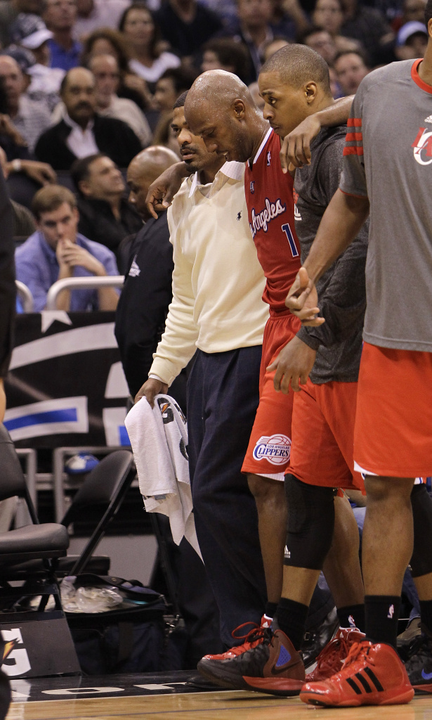 Los Angeles Clippers' Chauncey Billups (1) is helped off the court after he was injured during the second half of an NBA basketball game against the Orlando Magic, Monday, Feb. 6, 2012, in Orlando, Fla. The Clippers won 107-102 in overtime.