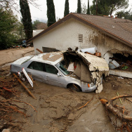 A debris flow damages a home after heavy rains caused mudslides February 6, 2010 in La Canada Flintridge, California