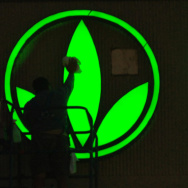 A worker cleans the logo on the Herbalife sign as finishing touches are put on the company's building in Torrance, Calif.