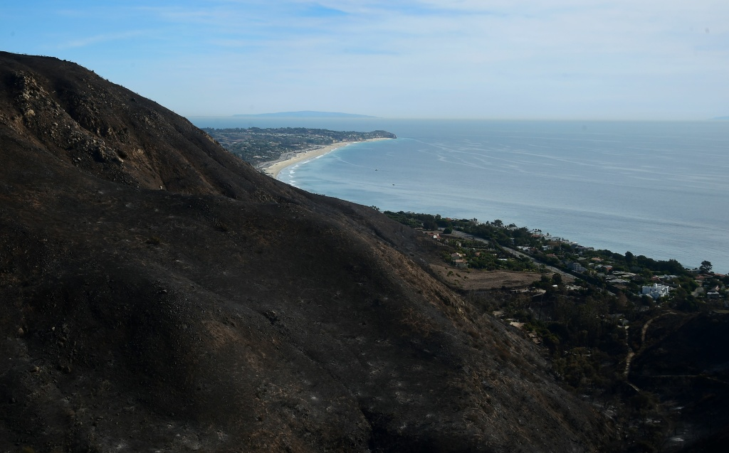 Blackened and charred hills from the Woolsey Fire which made it all the way to the Pacific Ocean, destroying houses along its way through canyons to coastal Malibu, California on November 15, 2018, one week after the fire began, as seen from Encinal Canyon Road.