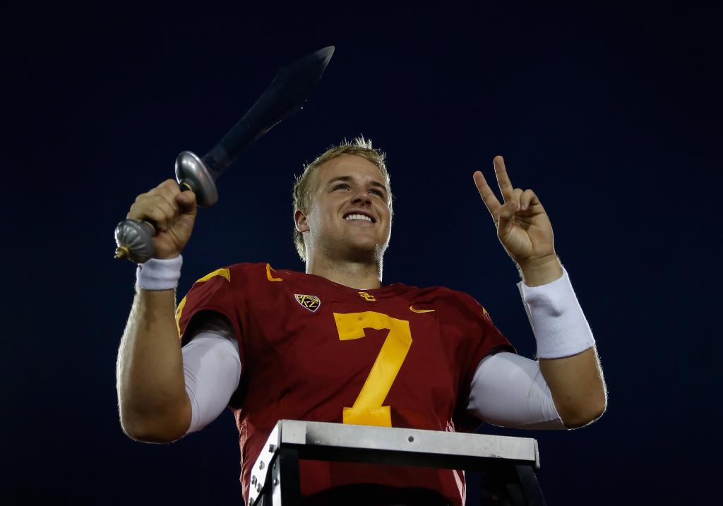 Quarterback Matt Barkley #7 of the USC Trojans celebrates his teams 50-6 victory over the Colorado Buffaloes at Los Angeles Memorial Coliseum on October 20, 2012.