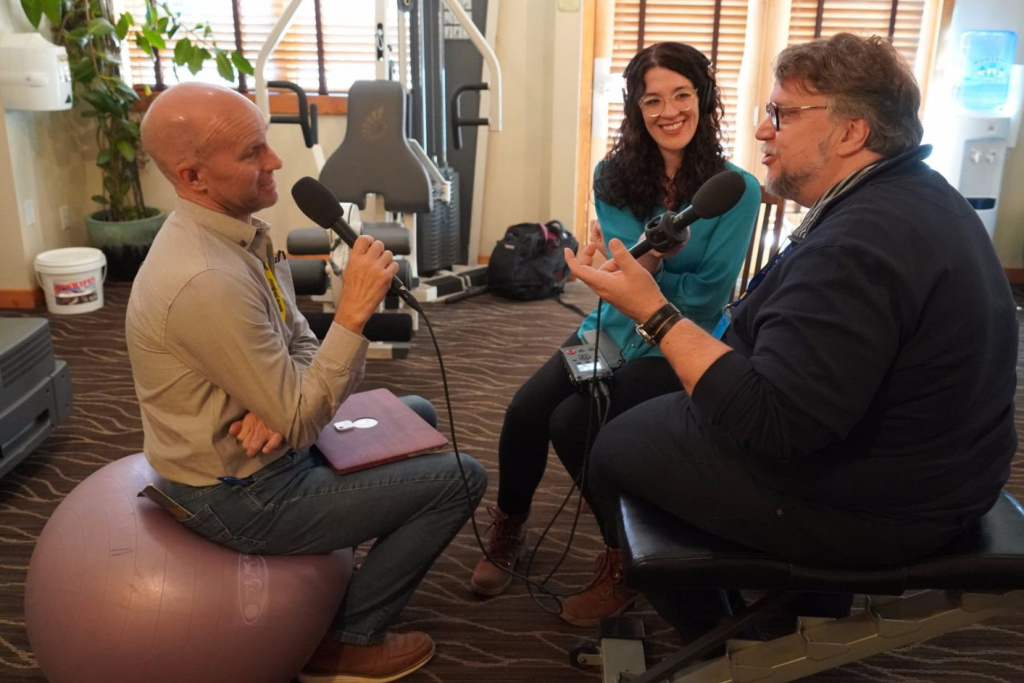 The Frame host John Horn and producer Michelle Lanz interview Guillermo del Toro in a gym at the Hotel Telluride during the Telluride Film Festival where del Toro's movie