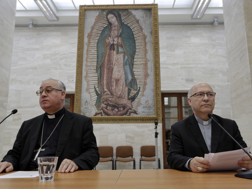 Members of Chile's bishops conference Luis Fernando Ramos Perez (right) and Juan Ignacio Gonzalez, at the Vatican on Friday. Following an emergency summit with Pope Francis, Chile's bishops offered him their resignations.