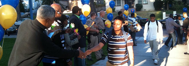 Alumni, civic leaders, administrators and police welcome students at Crenshaw High School on the first day of classes.