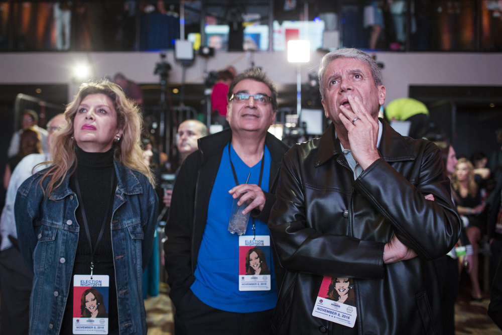 """Kamala Harris supporter Reza Ghavami watches coverage of the presidential race during California U.S. Senate candidate and California Attorney General Kamala Harris' election night watch party at The Exchange LA on Tuesday night, Nov. 8, 2016. """"I was hoping to celebrate Hillary's triumph,"""" he said. """"But I'll call [Trump] my president, because that's democracy."""""""