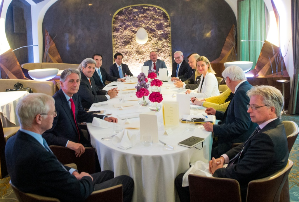 US Secretary of State John Kerry (third from the left) and representatives of the EU+3 attend a meeting at the Palais Coburg Hotel, the venue of the nuclear talks in Vienna, Austria on June 28, 2015. Talks between Iran and major powers on finalizing a historic nuclear deal will go beyond the June 30 deadline, a spokesman for the Iranian delegation in talks in Vienna said Sunday.
