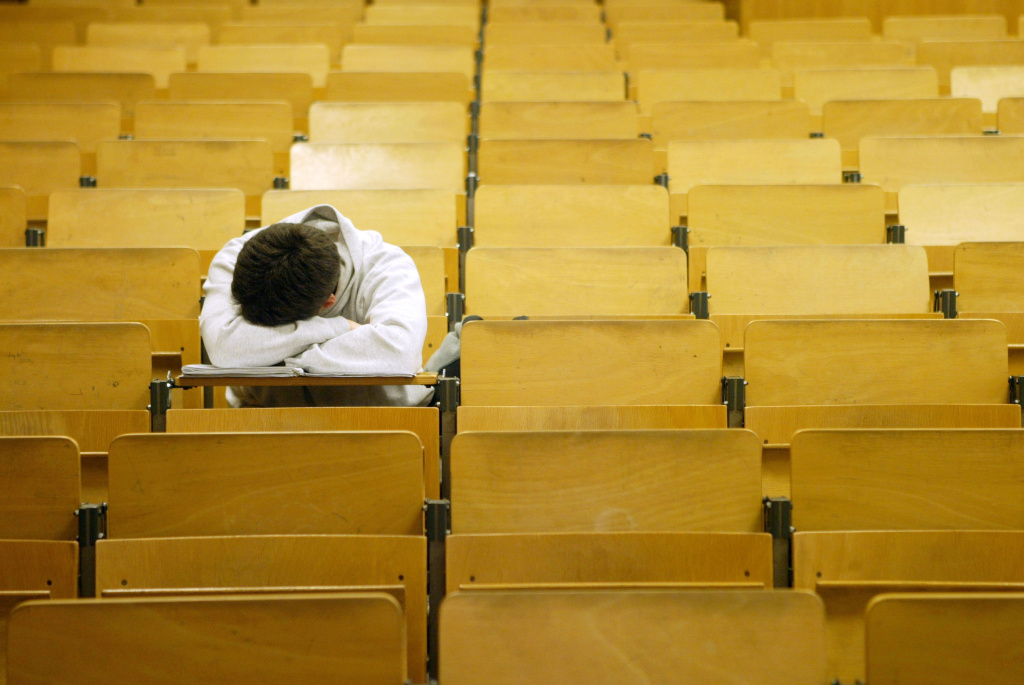 A student naps in a lecture hall at the Freie Universitaet January 13, 2003 in Berlin, Germany.