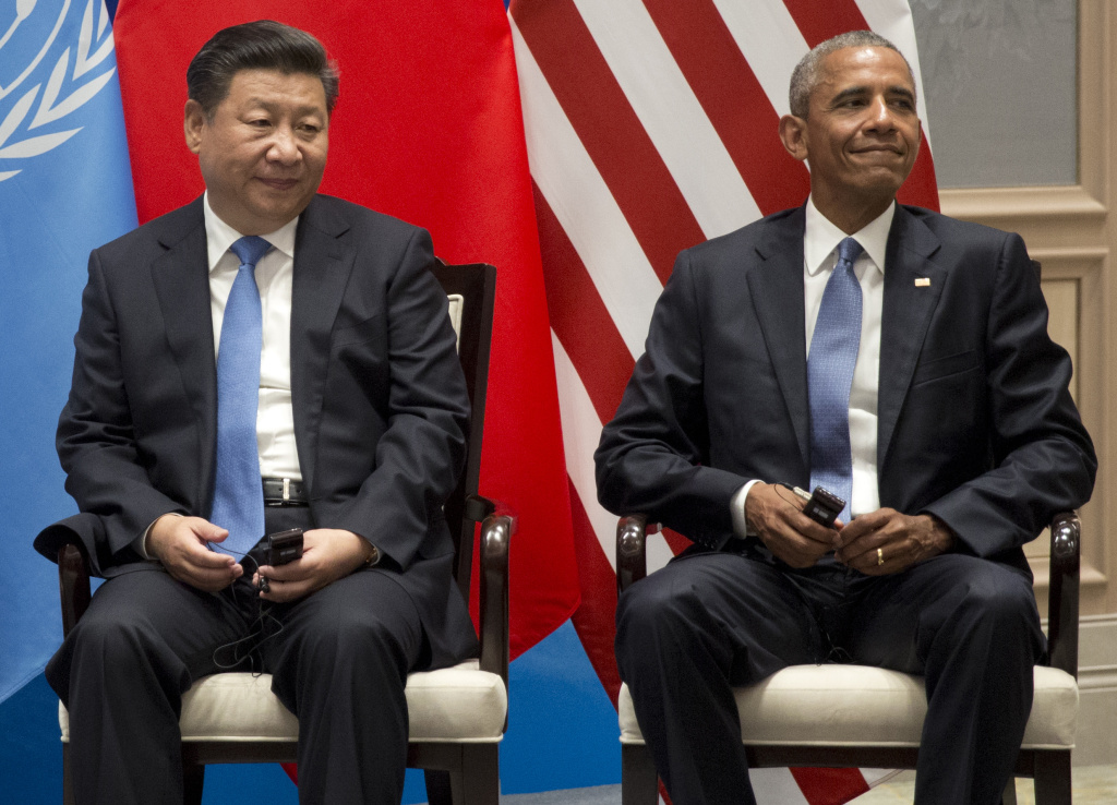 U.S. President Barack Obama, right, and Chinese President Xi Jinping sit together during a climate event at the Ruyi Hall at West Lake State Guest House in Hangzhou in eastern China's Zhejiang province, Saturday, Sept. 3, 2016. (AP Photo/Carolyn Kaster)