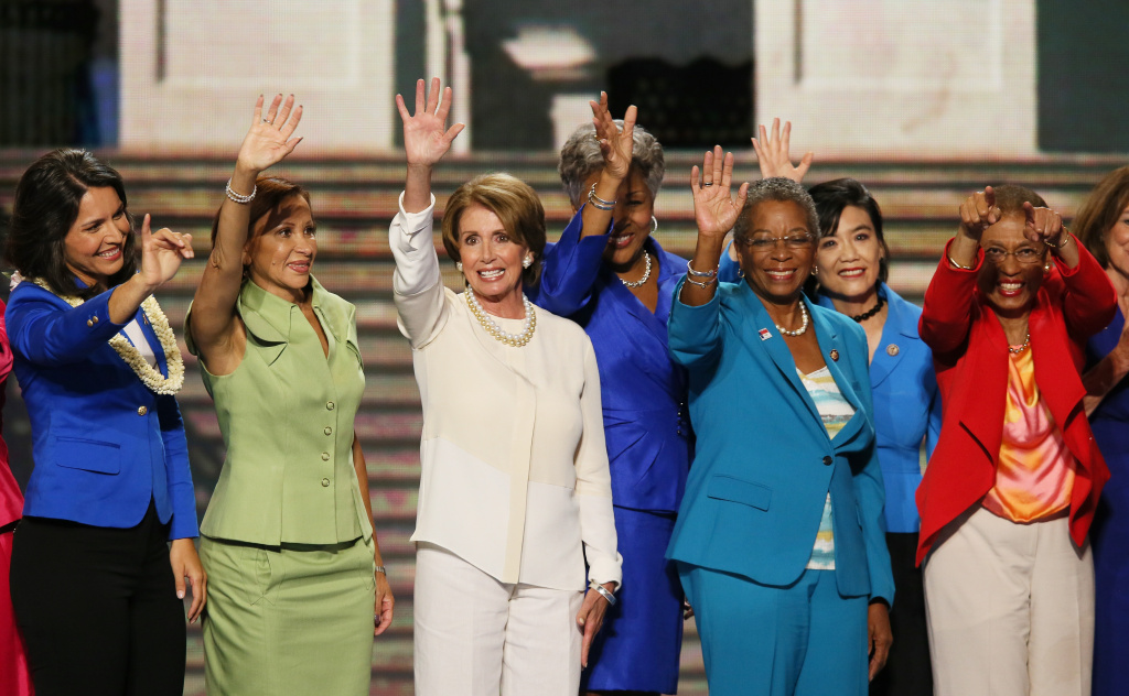 House Minority Leader Sen. Nancy Pelosi (D-CA) (C) waves on stage with other female members of Congress during day one of the Democratic National Convention at Time Warner Cable Arena on September 4, 2012 in Charlotte, North Carolina.