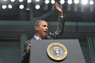 US President Barack Obama waves as as he finishes his address to military personnel at the Naval Air Technical Training Center of the Pensacola Naval Air Station June 15, 2010 in Pensacola, Florida.