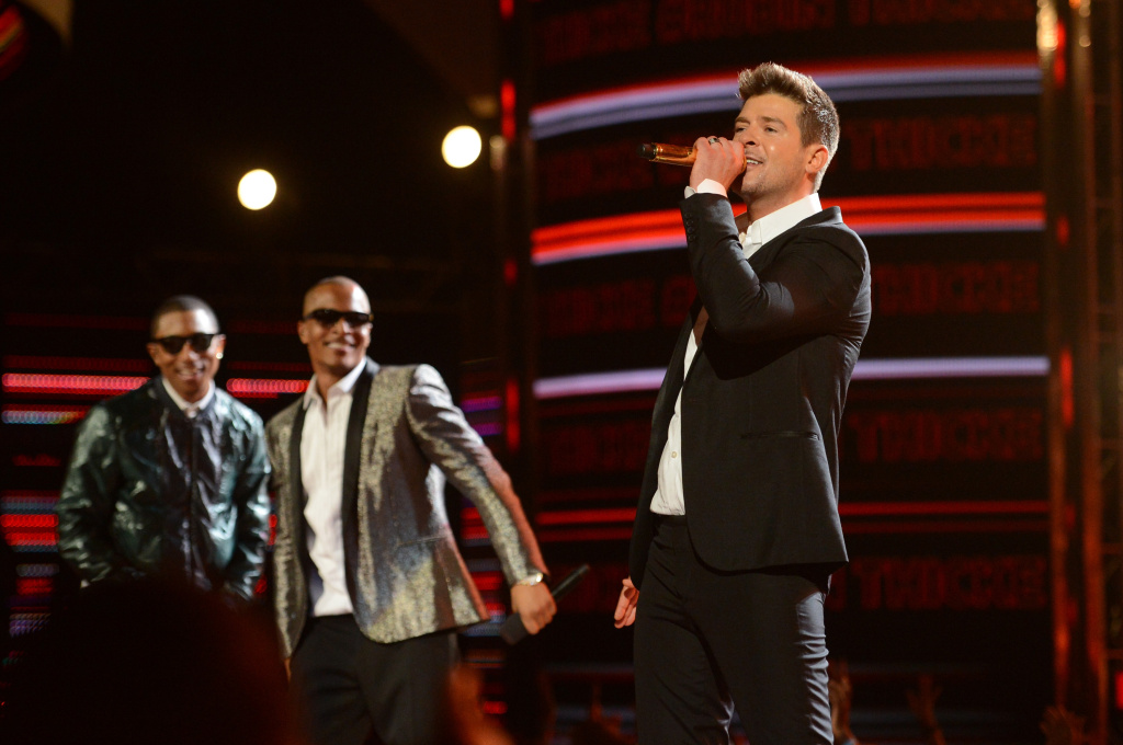 (L-R) Recording artists Pharrell Williams, T.I. and Robin Thicke perform onstage during the 2013 BET Awards at Nokia Theatre L.A. Live on June 30, 2013 in Los Angeles, California.