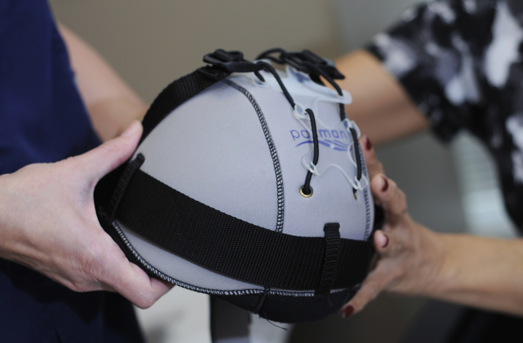 These cooling caps help limit hair loss in breast cancer patients