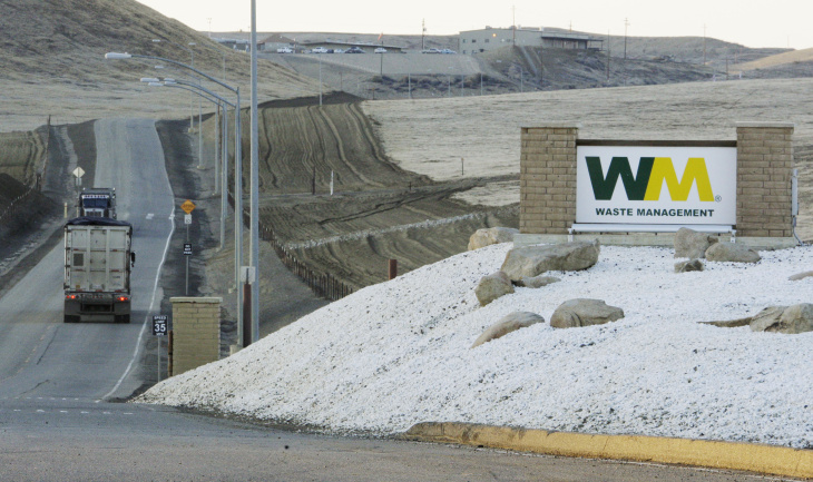 File: In this Dec. 8, 2009 file photo trucks haul material to the Waste Management landfill site just outside Kettleman City, Calif.