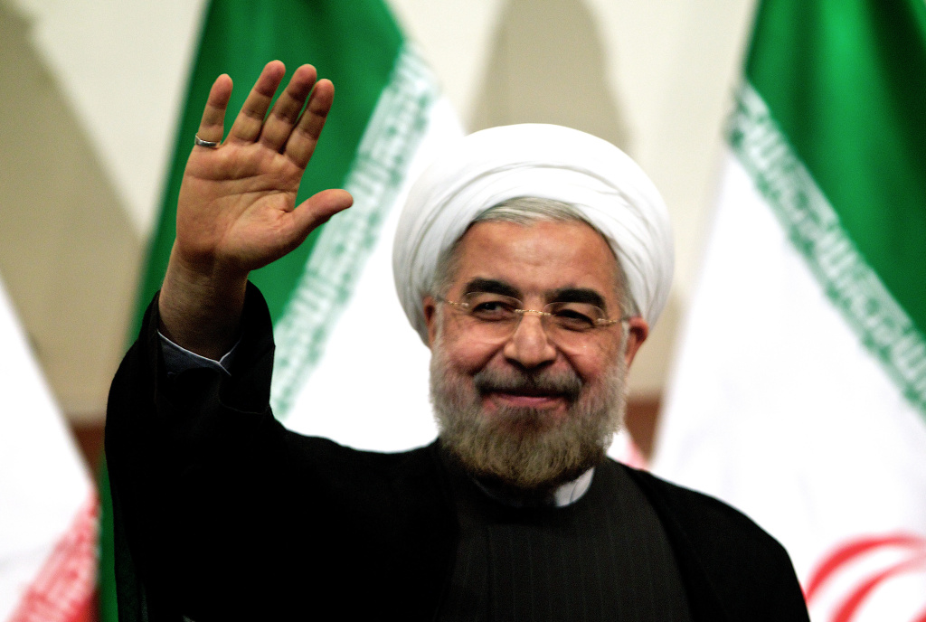 Iranian president-elect Hassan Rowhani waves as he attends a press conference in Tehran on June 17, 2013. Rowhani expressed hope that Iran can reach a new agreement with major powers over its disputed nuclear programme, saying a deal should be reached through more transparency and mutual trust.